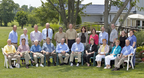 Group photo from 2005 retreat.  Standing, left to right: Keith Yehle, Mary Lee Hummert, Bob Woody, Robert Hall, Prem Paul, Duane Nellis, Lisa Freeman, Joan Hunt, Alan Tomkins, James Guikema, Stacy Betz, Sally Hayden.  Seated, left to right: Robert Barnhill, Steve Warren, Dick Schiefelbusch, David Shulenburger, Alan Leshner, Robert Hemenway, Mabel Rice, Barbara Atkinson, Kathleen McCluskey-Fawcett, Jim Roberts
