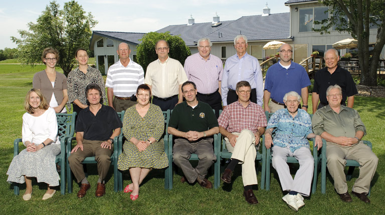 Group photo from 2009 retreat.  Standing, left to right: Megan Blossom, Evelyn Haaheim, Paul Terranova, George Stewart, Robert Duncan, Jerry Jaax, Michael Johnson, Kerry Taylor.  Seated, left to right: Shelley Smith, Peter Smith, Mabel Rice, Kevin Roth, Steve Warren, Dick Schiefelbusch, John Colombo