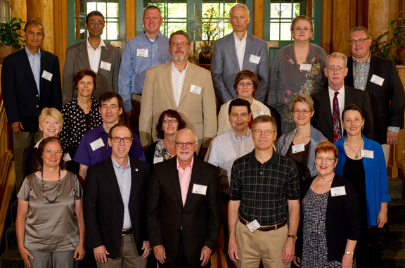 Group photo from 2013 retreat.  First row, left to right: Melinda Merrill, Danny Anderson, Joe Steinmetz, Steve Warren, Mabel Rice. Second row, left to right: Mary Lee Hummert, Glenn Horton-Smith, Kimberly Kirkpatrick, Rodolfo Torres, Regina Werum, Evelyn Haaheim. Third row, left to right: Deb Teeter, Gary Allen, Sara Rosen, Mike O'Brien. ​Fourth row, left to right: Arun Somani, Amit Chakrabarti, Matt Schuette, Mardy Eimers, Susan Kemper, Michael Zeleny